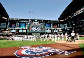 The Colorado Rockies and Arizona Diamondbacks line up during the national anthem prior to the start of their opening day MLB baseball game Monday, April 6, 2009 in Phoenix. (AP Photo/Matt York)
